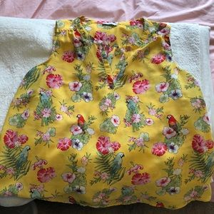 Sleeveless yellow top with floral and bird pattern